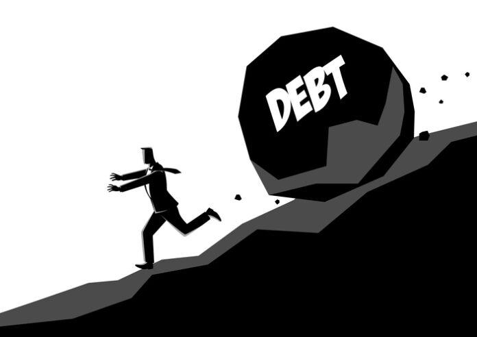 man running away from boulder of government debt