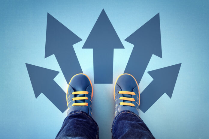 Arrows pointing away from shoes depicting education choices.