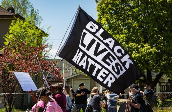 black lives matter flag at a protest