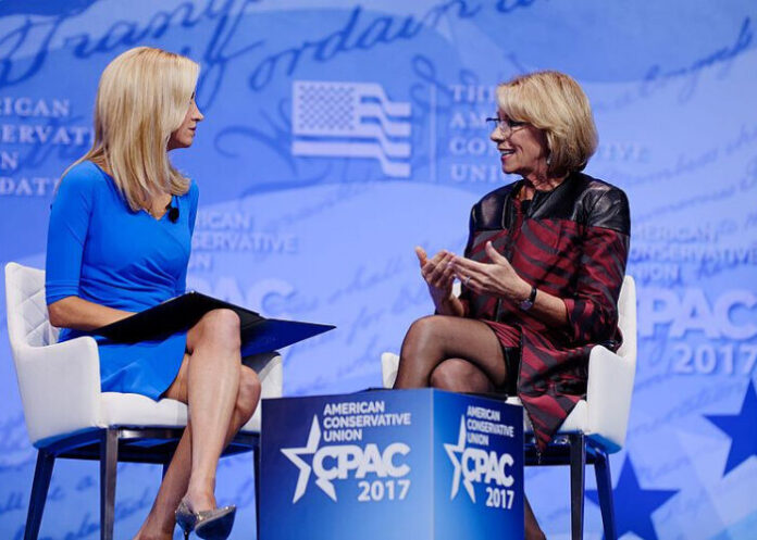 U.S. Secretary of Education Betsy DeVos (right) speaking at CPAC.