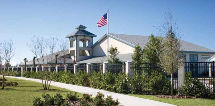 Charter School in Florida with Landscaping and American Flag Flying.