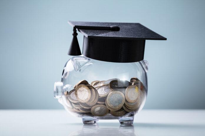 economic education socialism piggy bank pennies graduation cap