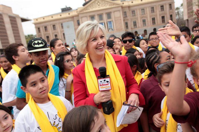 Lisa Graham Keegan with students at school choice rally in Kentucky
