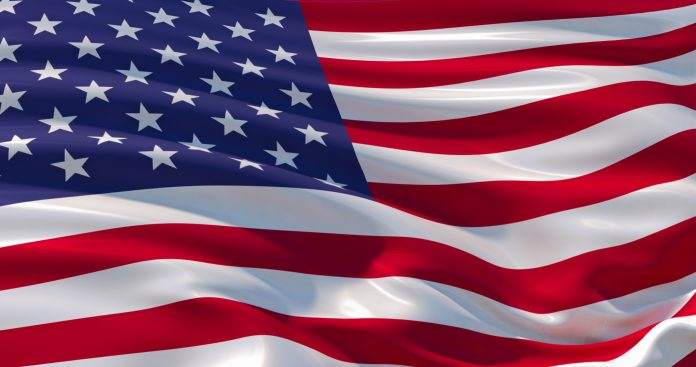 American flag, wrinkled. Old Glory in the wind, colorful background