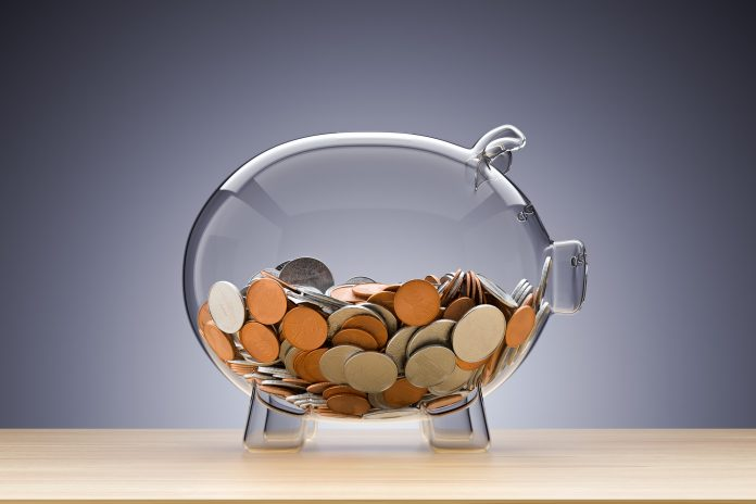 Glass piggy bank with coins , 3d render, Ohio spending