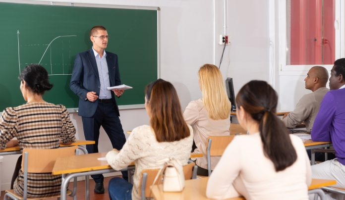 Teacher is giving lecture for students in the class