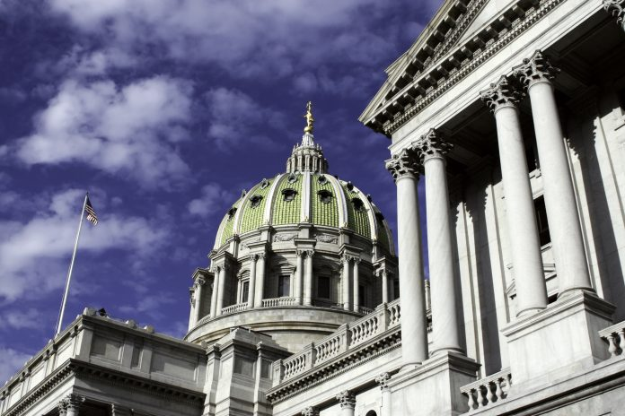 Pennsylvania Capitol Building in Harrisburg with blue sky background