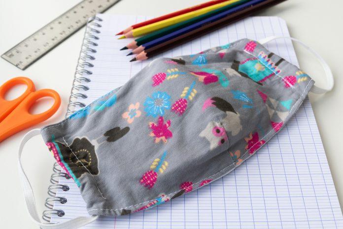 Back to school coronavirus covid 19 mask notebook pencils