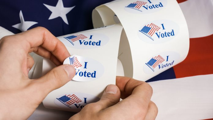 I voted stickers with united states flag with human hands