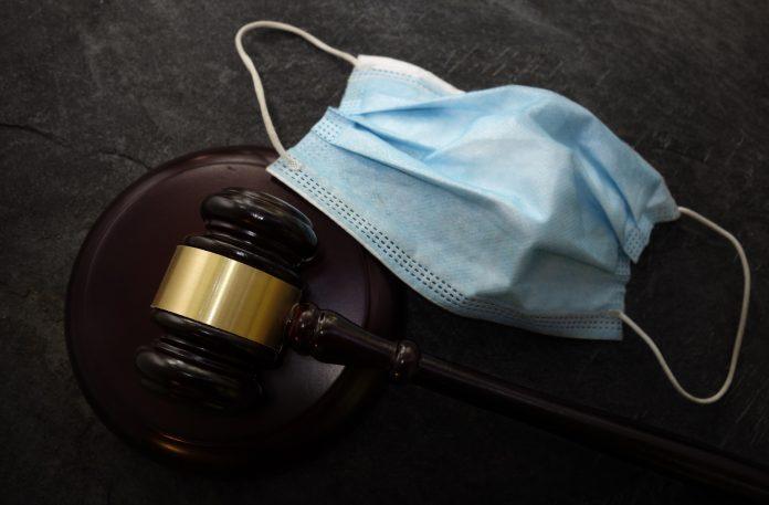 Court legal gavel and facemask -- Coronavirus mask mandate concept